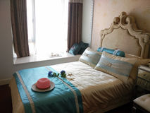 Red hat on the bed. Interior of a fashion bedroom with a red hat on the bed Stock Photo