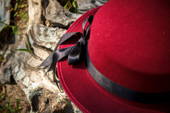 Red hat and black ribbon bow. With trunk background Stock Images