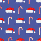 Red Hat and Candy Cane Seamless Pattern. Winter Background Stock Photography