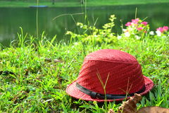A Red hat on the grass Stock Photography