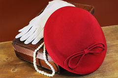 Red hat on leather case Royalty Free Stock Photo