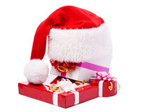 The red hat in the presents. The Santa red hat in the presents stock images