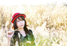 Red hat pretty girl02. Thai pretty girl wear the red hat in meadow Royalty Free Stock Photography
