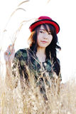 Red hat pretty girl03. Thai pretty girl wear red hat in meadow Royalty Free Stock Image