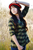 Red hat pretty girl06. Thai pretty girl wear red hat in meadow Stock Image