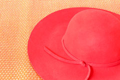 Red hat on red mat Royalty Free Stock Images