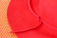 Red hat on red mat Royalty Free Stock Image