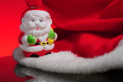 Red hat with santa claus. Santa claus hat close up. A little Santa Clause is walking on snow. Christmas is almost here Stock Photography