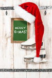 Red hat for Santa Claus and white ice skates. Merry X-Mas Royalty Free Stock Images