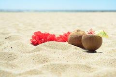 Red Hawaiian lei garland on the beach Royalty Free Stock Image
