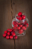Red hawthorn berries in a glass jar Stock Images