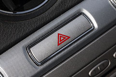 Red hazard in car interior. Car hazard warning flashers button with visible red triangle. Red hazard in car interior stock photography