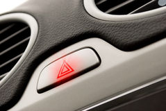 Red triangle warning light in car Stock Photography