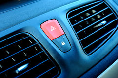 Red hazard light in car. Red triangle warning light on a car dash royalty free stock images
