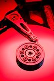 Red HDD. Red lit hard drive platter highlight bottom Stock Photo