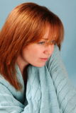 Red Head with Blue Blanket Stock Photo