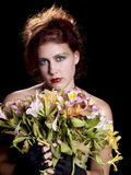 Red Head with flowers Royalty Free Stock Photography