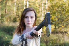 Red head girl with axe in the forest Stock Photography