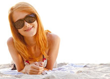 Red-head girl at the beach in sunrise. Royalty Free Stock Image