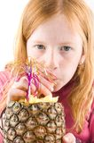 Red head girl is drinking from a pineapple Royalty Free Stock Images