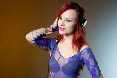 Red head Girl enjoying music Stock Photos