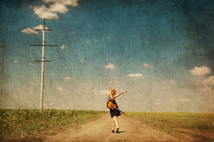 Red-head girl with guitar. Photo in old image style. Royalty Free Stock Photos