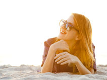 Red-head girl with headphones royalty free stock photography