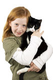 Red head girl holding a kitten Stock Images