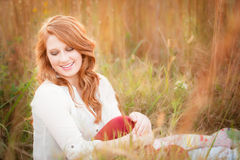 Red head girl smiling in field Royalty Free Stock Photo