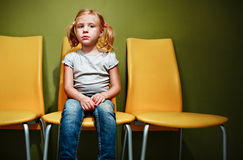 Red head girl waiting in reception room. Stock Photography