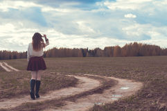 Red head girl walking on the forest road Royalty Free Stock Photography
