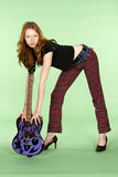 Red Head Rock and Roll Guitar Player Bending Over. Female Red Head Rock and Roll Guitar Player Bending Over Stock Photo