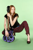 Red Head Rock and Roll Guitar Player Squating. Female Red Head Rock and Roll Guitar Player Squating Stock Photos