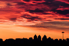 Red head ruler at sunset. Colorful fiery sky at sundown in the city - altocumulus clouds Royalty Free Stock Photo