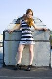 Red head teen model on roof Stock Photo