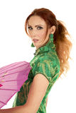 Red head woman Asian dress with umbrella side close Royalty Free Stock Photography