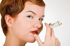Red-head woman with dollar strasses Royalty Free Stock Photos