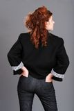 Red head woman with hands in back pockets Royalty Free Stock Photo