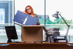 The red head woman moving to new office packing her belongings Stock Photos