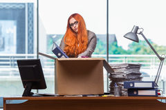 The red head woman moving to new office packing her belongings Royalty Free Stock Photography