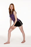 Red Head Woman Stretching Calf Muscle Stock Images