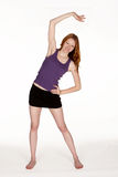 Red Head Woman Stretching Side Royalty Free Stock Photo