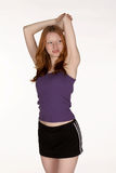 Red Head Woman Stretching Tricep Stock Photo