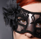 Red head woman wearing mask Stock Image