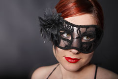 Red head woman wearing mask Stock Images