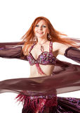 Red-headed belly dancer in dance turn Stock Photo