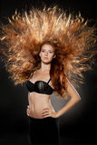 Red headed fashion model with raised hair Stock Images