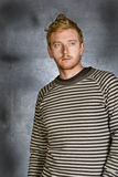 Red Headed Male against Grunge Background Stock Photo