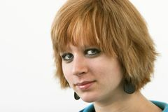 Red headed teen. Teen with short red hair isolated against a white background. Narrow depth of field Stock Images