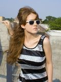 Red headed teen on rooftop Stock Photo